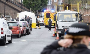 Police officers at the scene of the shooting in Wood Green on Friday.
