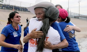 Mexicans hug each other during an event called 'Hugs, No Walls' in front of the border fence separating Mexico from the US, in Ciudad Juárez, Mexico, in August. For two minutes there were no walls for 250 families of undocumented immigrants in the United States.