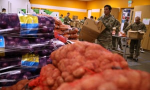 Members of the California national guard help pack boxes of fruits and vegetables at Second Harvest food bank in San Jose, California.