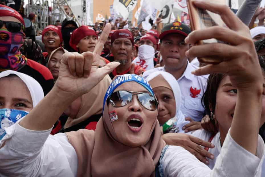 Supporters of Indonesian presidential candidate Prabowo Subianto hit the streets near Pakansari Stadium in Bogor at the weekend