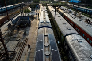 Solar panels added to a train roof in New Delhi aim to reduce carbon emissions and modernise India's vast colonial-era rail network
