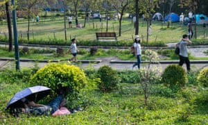 People are seen at the Nam Cheong public park during the lockdown amid the Coronavirus pandemic in Hong Kong.