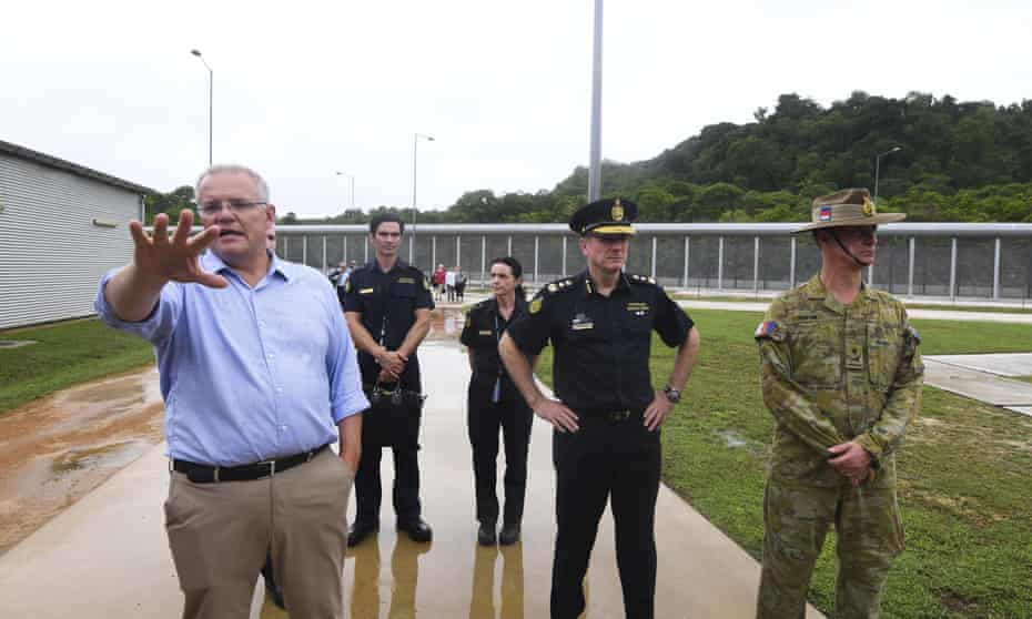 Scott Morrison tours the detention centre on Christmas Island in what has been criticised as a '$185m press conference'.