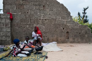 A woman and her two sick daughters in Kaleri, a neighborhood on the outskirts of Maiduguri where hundreds of displaced families live.