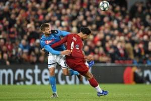 Napoli's Fernando Llorente tussles with Liverpool's Virgil van Dijk.