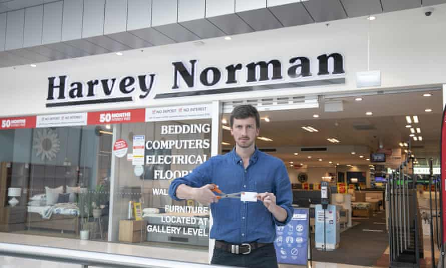 Choice campaigner Patrick Veyret pretends to cut up a credit card outside a Harvey Norman store. Harvey Norman are one of the winners of the 2020 Shonky awards due to their 'toxic partnership' with Latitude Finance.