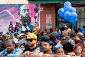Fans and community members gather along the procession route for Nipsey Hussle after his memorial at the Staples Center in Los Angeles, California, on 11 April 2019.