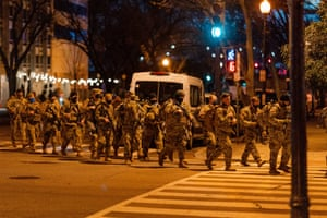National Guard troops march towards an entry point into the inauguration's Red Zone
