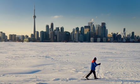 The frozen Lake Ontario with Toronto skyline in the background.