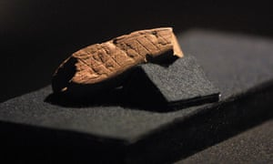A 77,000-year-old piece of red ochre with a deliberately engraved design discovered at Blombos Cave, South Africa