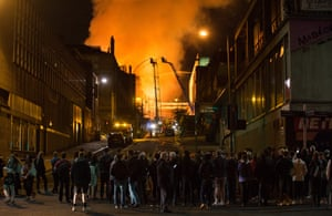 Crowds gather at a safe distance as Glasgow School Of Art burns.
