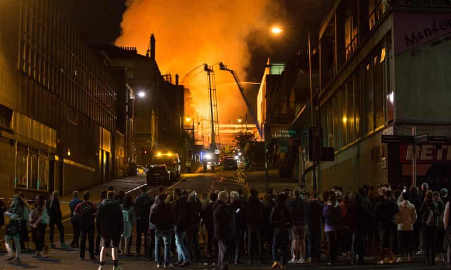 Crowds in Glasgow watch as the school of art burns.
