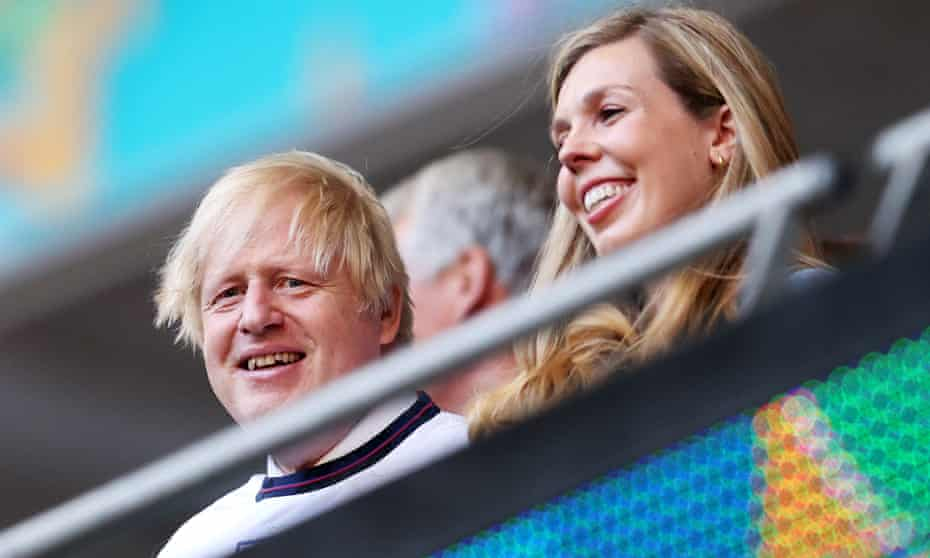 Boris and Carrie Johnson watching the Euro 2020 football tournament in London earlier this year. The couple are expecting their second child.