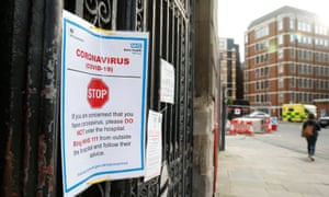 A sign on a gate at St Bartholomew's Hospital, London, where two deaths of patients who had tested positive for Covid-19 were confirmed by the Barts Health NHS Trust in London.