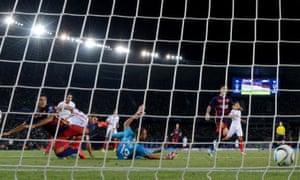 Rafinha, left, scores Barcelona's third goal.