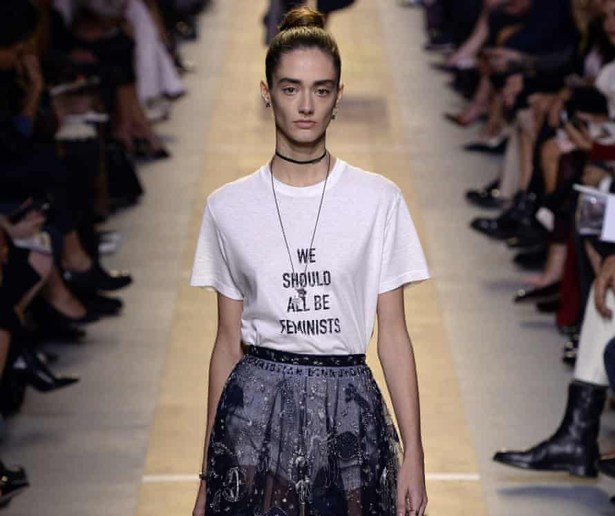 Model on the catwalk wearing a t-shirt saying 'we should all be feminists'