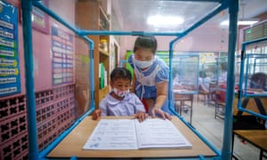 Students attend class as Thai schools reopen across the country following the easing of coronavirus restrictions. Staff and pupils will have to observe government-imposed guidelines such as social distancing and the use of face masks.