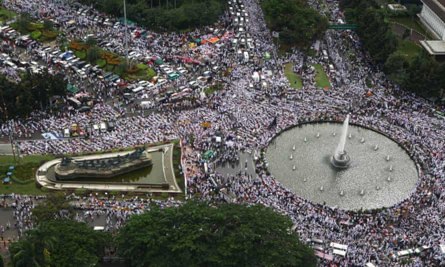 A huge crowd gathers at the national monument in Jakarta to protest against the city's Christian governor.