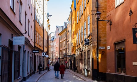 People walking in the narrow streets in Stockholm's old town, Gamla Stan.