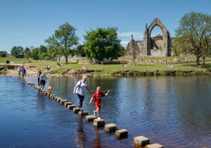 Bolton Abbey, North Yorkshire People cross the River Wharfe