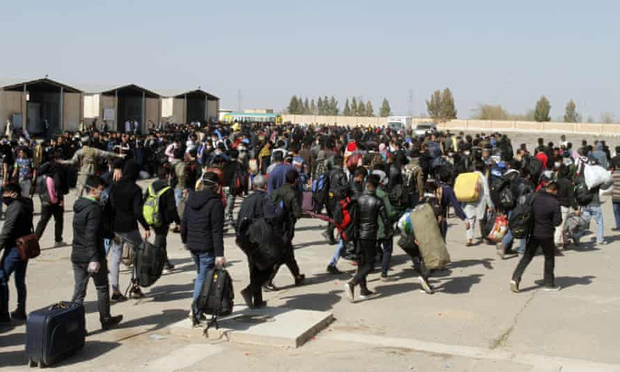 Thousands of Afghan refugees enter Afghanistan at the Islam Qala border crossing with Iran, in the western province of Herat.