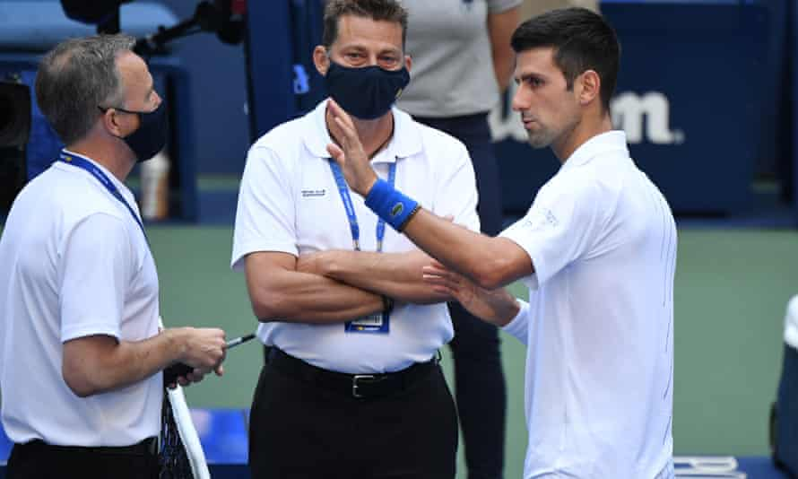 Novak Djokovic argues his case with officials but to no avail at Flushing Meadow.