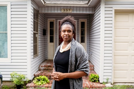 Tara Wicker stands in front of the home she grew up in and still lives in today.
