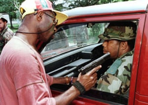 Corporal Alan Nangrume points his pistol into the face of a fellow soldier who he accused of being disloyal to sacked Papua New Guinean Army Chief Brigadier-General Jerry Singirok at Murray Barracks 21 March 1996. Tension between senior army officers and lower ranked soldiers loyal to Singirok has become more hostile during the civil unrest in this South Pacific Nation.
