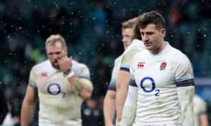 A dejected Jonny May of England trudges off the Twickenham pitch after England's 25-14 loss to Ireland.