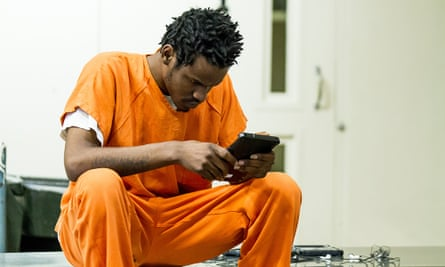 An inmate using a tablet from Edovo, a company that wants to help reform the criminal justice system by bringing educational content into prisons.