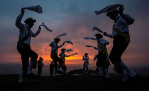 Morris dancers perform on Eccles Pike in Derbyshire before sunrise as part of the Celtic festival of Beltane.