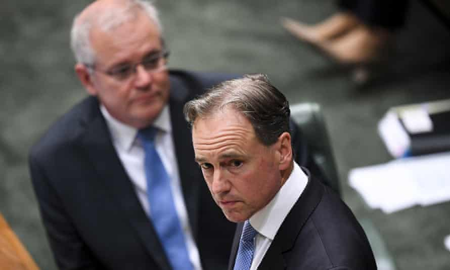 Australian health minister Greg Hunt speaks in parliament as prime minister Scott Morrison watches on