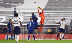 Chelsea keeper Edouard Mendy attempts to claim the ball.
