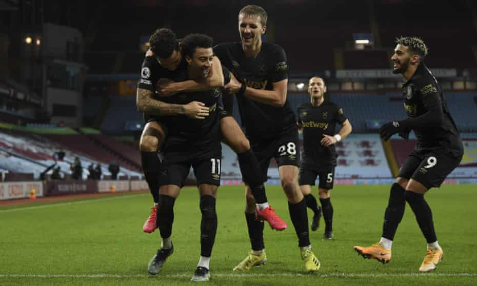 Jesse Lingard is mobbed by his new West Ham teammates.