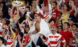Japan fans celebrate their team's first try against Scotland