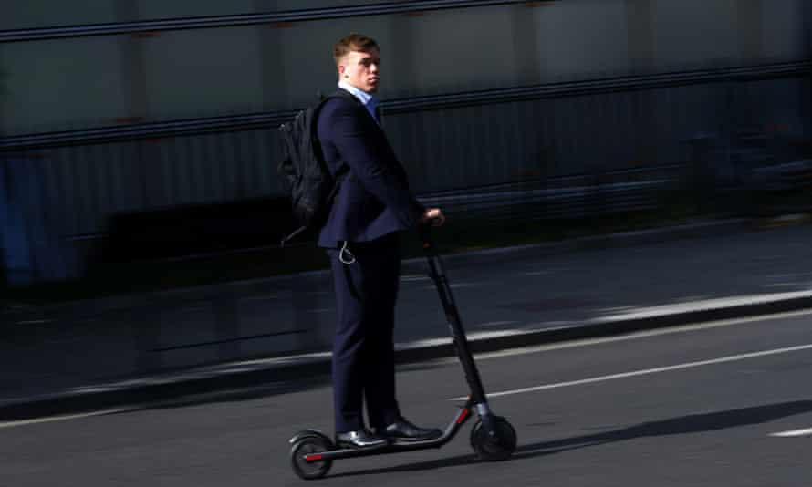 A man riding an e-scooter