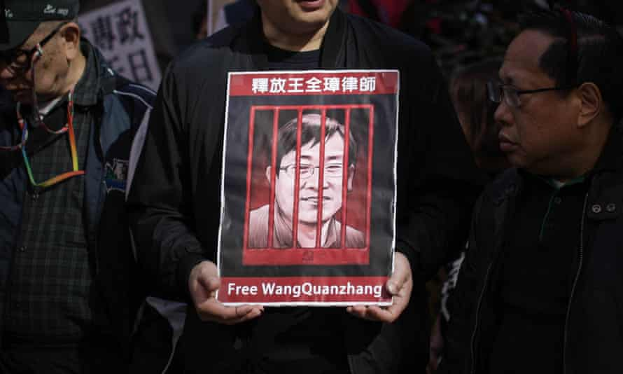 A protester holds a poster of Wang Quanzhang during a demonstration in Hong Kong.