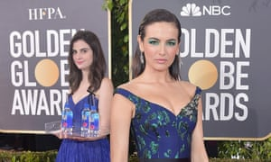 Actor Camilla Belle, right, with Fiji Water hostess Kelleth Cuthbert at the 2019 Golden Globes.