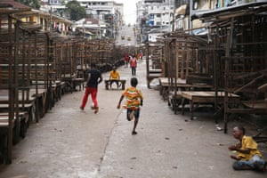Monrovia, Liberia. Young boys play football in an empty market. Liberians will head to the polls on 10 October to elect a new president