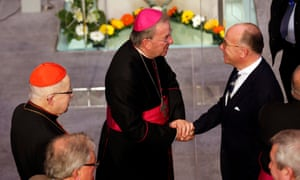Luigi Ventura shakes hands with the French interior minister, Bernard Cazeneuve, at the inauguration of Notre-Dame of Creteil Cathedral in 2015.