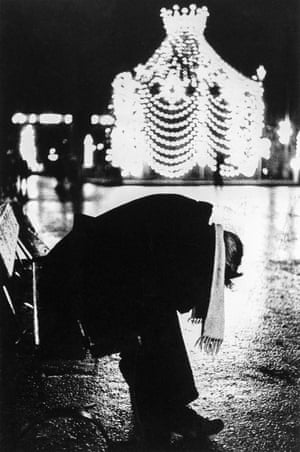 A man on a bench in George Square, Glasgow on New Year's Eve, 1966