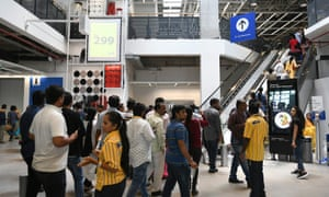Customers enter at the new IKEA store.