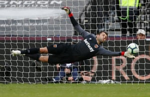 Lukasz Fabianski makes a diving save to deny Ross Barkley.