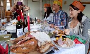 A family enjoy a traditional Christmas dinner