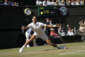 Novak Djokovic stretches for a forehand return.