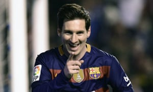 Barcelona's Lionel Messi hits the net for their second goal.
