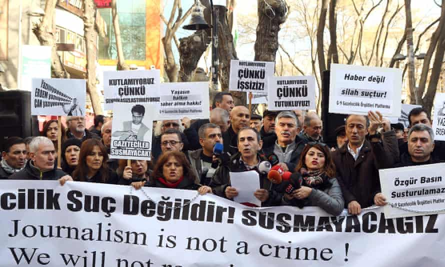 Turkish journalists hold a banner during a demonstration in support of jailed journalists Can Dundar and Erdem Gül.