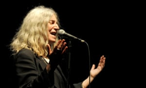 Patti Smith, 'now unfeasibly lithe, bovver-booted', performs at the Manchester Apollo on Tuesday.
