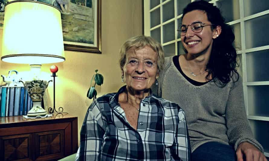 Dora Grazzini, 83, and Maria Urbani, 26, in the apartment they share in Milan.