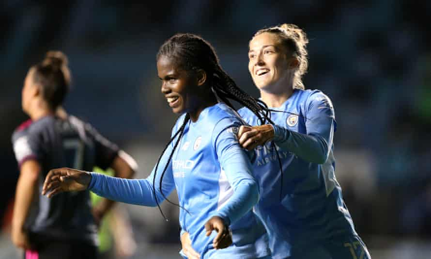 Khadija Shaw celebrates with Filippa Angeldal after completing a hat-trick for Manchester City.